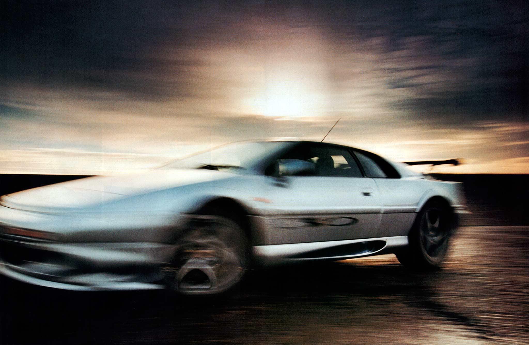 1999 Lotus Esprit Sport 350 Vs 1999 Porsche 911 Carrera 4