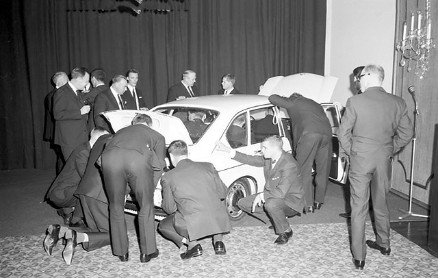 Below: The new VW 411 created quite a stir when it was launched, but its styling left people cold. Most interest centred around the engine, as suggested by this press launch photo!
