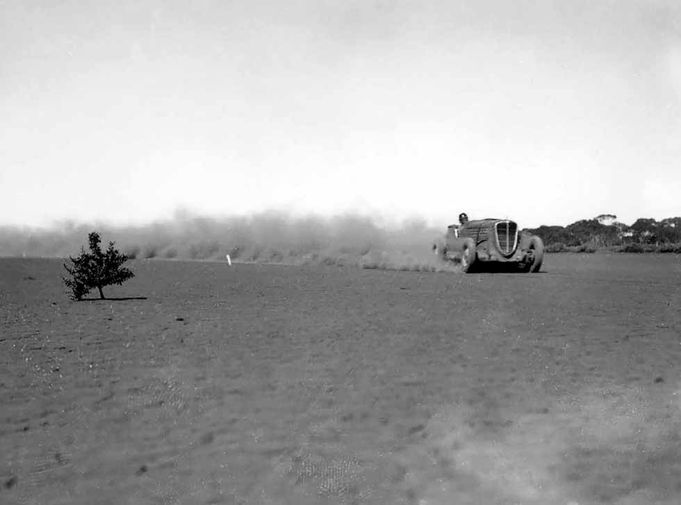 Neil Baird's Hudson Terraplane kicks up the dust during a 1937 record run. He clocked up 88 miles in the hour