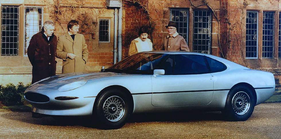 Sir John Egan, Jim Randle Keith Helfet and Sir William Lyons outside Wappenbury Hall with an early full scale mock up