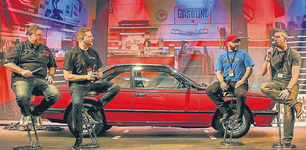 Discovery teammates Mike Brewer, Paul Cowland, Jimmy de Ville and Ant Anstead unveil the BMW 635CSi on the live stage at the NEC.