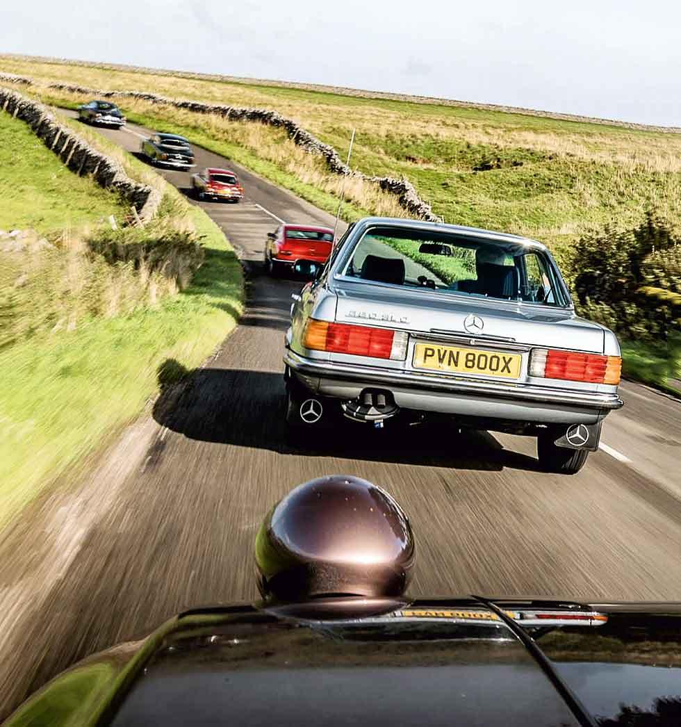 Front to rear: Aston Martin V8, Gordon Keeble GK1, Mercedes-Benz 380SLC C107, Porsche 928 S4, MGB GT V8, Bristol 410