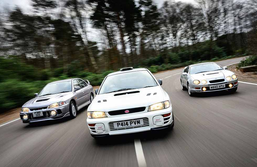 1994 Toyota Celica GT-Four (ST205) vs. 1997 Subaru Impreza WRX Type RA STI Version III and 1997 Mitsubishi Lancer Evolution IV GSR - Japanese rally replicas
