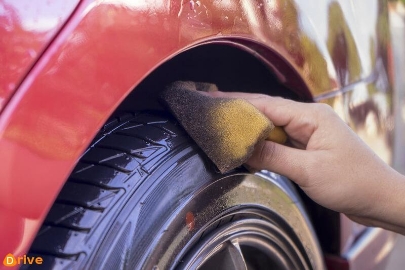 Man cleaning and polishing tires