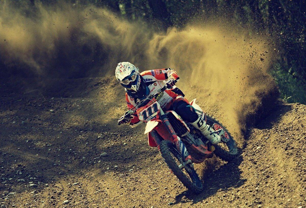 Dirt bike rider on race track